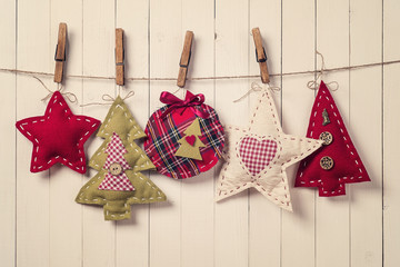 Christmas tree ornaments on wood background