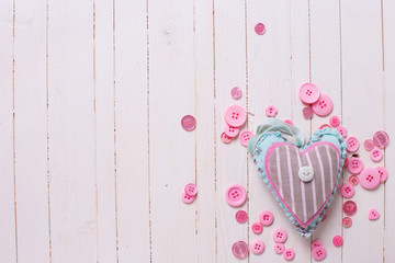 Textile heart and pink buttons