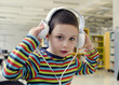 Child listening with headphones