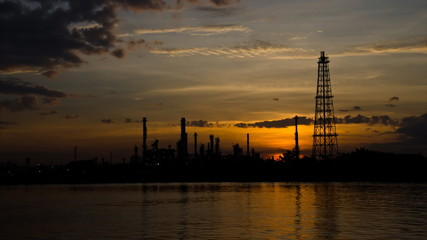 Oil refinery at dawn. Time lapse.