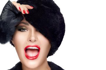 Winter Beauty. Fashion Model Girl in Fur Hat Covering one Eye