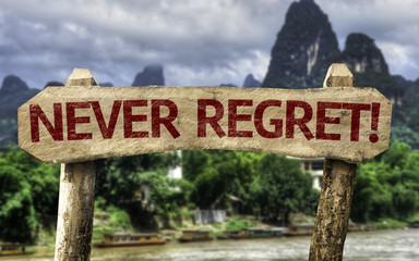 Never Regret sign with a forest background