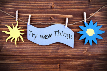 Light Blue Lable Saying Try New Things