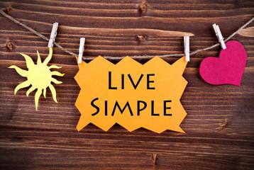 Orange Lable Saying Live Simple