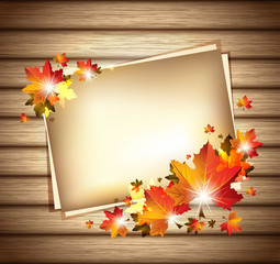 Autumn Foliage with Paper Sheets on Wooden Background