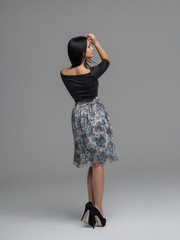 Young beautiful caucasian brunette in gorgeous dress, motion sho