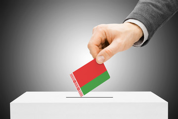 Voting concept - Male inserting flag into ballot box - Belarus
