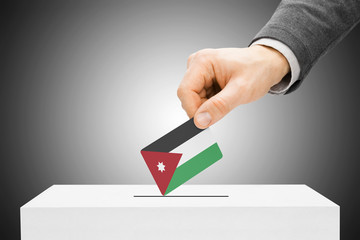 Voting concept - Male inserting flag into ballot box - Jordan