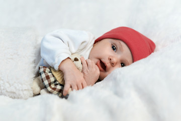 baby in red hat smiling