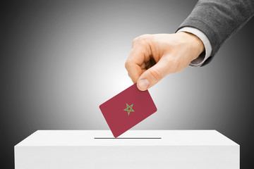 Voting concept - Male inserting flag into ballot box - Morocco