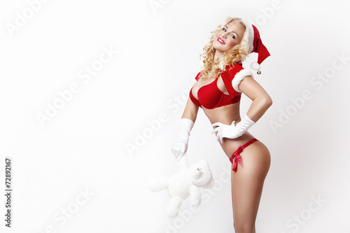 canvas print picture beautiful and sexy woman dresses as a sexy santa claus