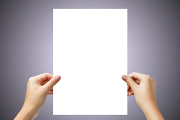 Hands holding a white page isolated on light purple background