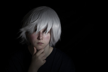 Teen Girl in Silver Wig on Black Background