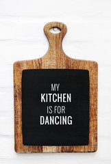 Quote MY KITCHEN IS FOR DANCING on cutting board. Rustic style
