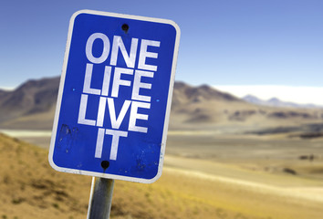 One Life Live It sign with a desert background