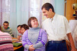 Leinwanddruck Bild - happy people with disability in rehabilitation center
