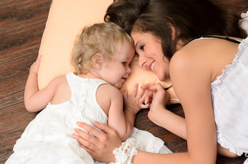 mother and daughter on pillow