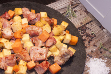 Meat, carrot and swede dice, on a stone plate