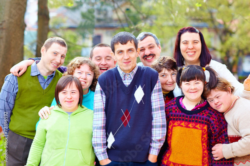 group of happy people with disabilities - 72896592