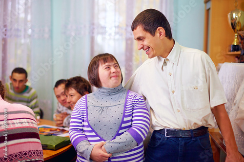happy people with disability in rehabilitation center - 72896599