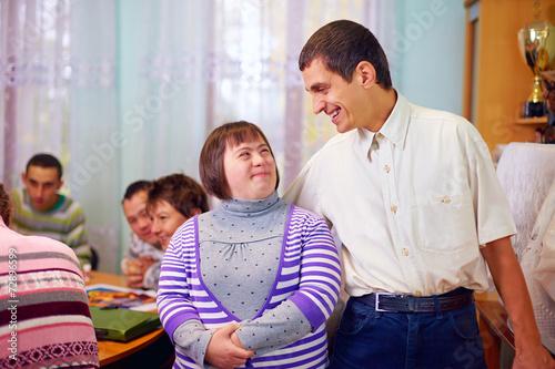 Leinwanddruck Bild happy people with disability in rehabilitation center