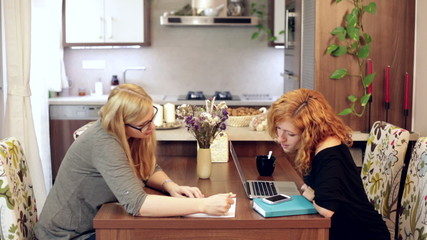 Female students making homework at home