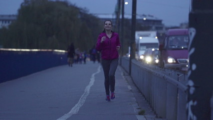 Woman jogging by the street in city, super slow motion, 240fps