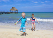 Kids running on the beach together