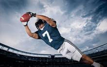 """Постер, картина, фотообои """"American Football Player Catching a touchdown Pass"""""""