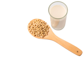 Soybean in a white bowl and a glass of soybean milk over white
