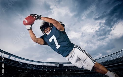 American Football Player Catching a touchdown Pass poster