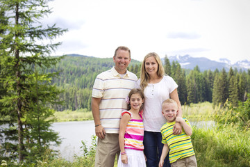 Beautiful Young Family Portrait in the Mountains
