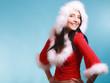 canvas print picture - Portrait woman wearing santa claus costume on blue