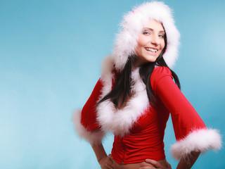 Portrait woman wearing santa claus costume on blue