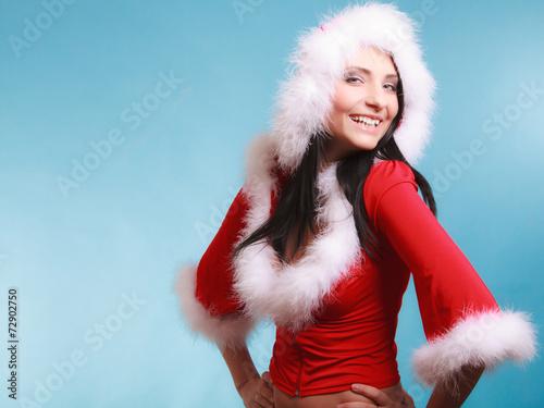 canvas print picture Portrait woman wearing santa claus costume on blue