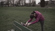 Woman stretching before jogging, super slow motion, shot at 240f