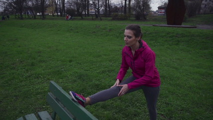 Young sporty woman stretching before jogging