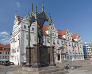 Luther statue and the town hall of Wittenberg, Germany