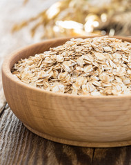 Oat flakes in a wooden bowl