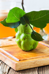 Ripe quince on wooden table