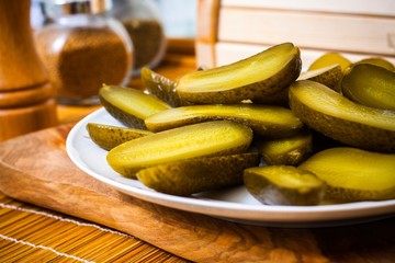 Sliced pickled cucumbers in plate