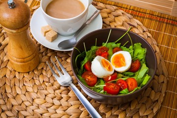 Ruccola salad with tomatoes, egg, coffee