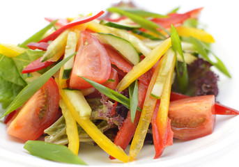 Salad with fresh vegetables on white plate