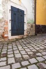 Iron door with cobble stones