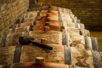 Barrels in Hungarian Wine Cellar with Maul