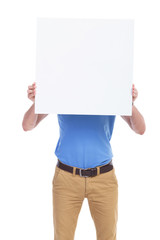 casual young man with board in front of face