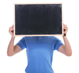 casual young man with blackboard in front of face