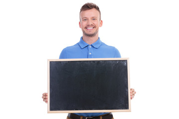 casual young man holds a blackboard