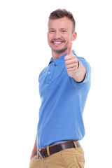 casual young man shows thumb up
