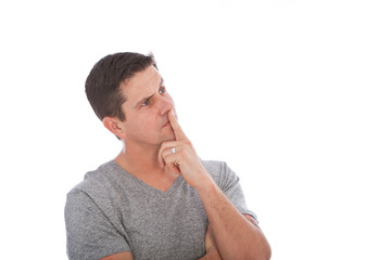 Middle Age Man Thinking with Finger on Lips